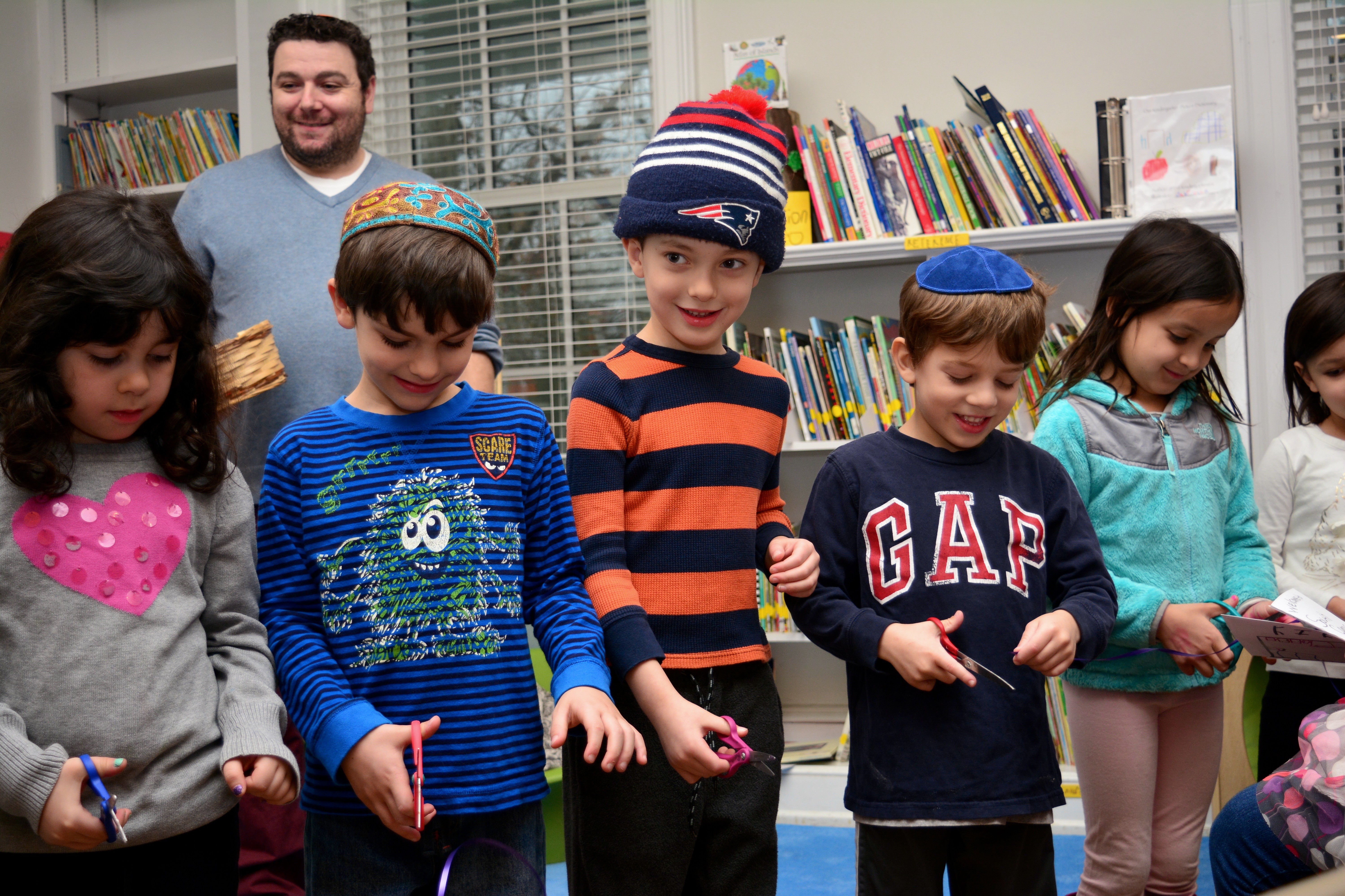 Kindergarten students celebrate the grand opening of the new South Campus Community Library with a ribbon-cutting ceremony.