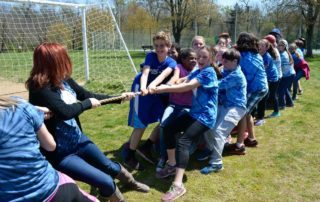 A joyful tug-of-war breaks out with Sixth Graders at Yom Sport (Field Day).