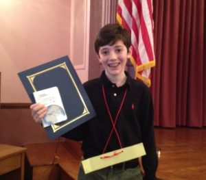 Sixth grader Ethan L. holds his certificate after winning second place at the DC Geography Bee.